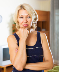 Depressed  mature blonde woman