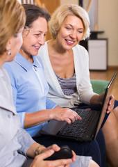 Senior ladies with laptop