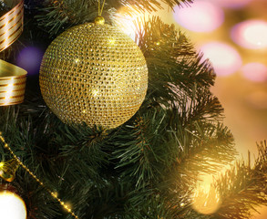 Golden ball on the Christmas tree branch