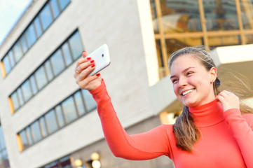 Happy woman taking photo picture