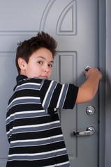 boy locks the door