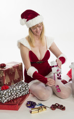 Woman wearing Santa costume wrapping presents