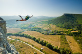 Fototapety base-jumper jumps from the cliff