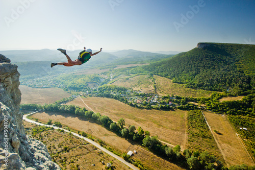 Foto op Plexiglas Luchtsport base-jumper jumps from the cliff