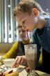 Boy drinks milk chocolate cocktail