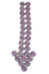 A heap of purple pills formed as arrow