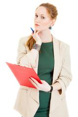 businesswoman wearing a green dress corrects document