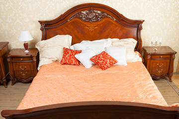 big luxurious double bed in the interior
