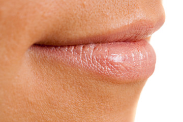 female open lips with applied pink lipstick, isolated on white