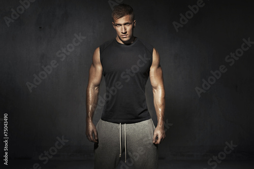 Tall, muscular man during the training