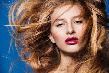 beautiful fashion model with magnificent hair  on blue
