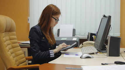 Businesswoman working with laptop at the office