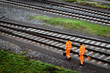 Two workers walking along railroad tracks - 75046800