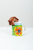 The hand-made eatable gingerbread houses on a cup and snow decor poster