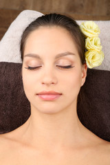 Beautiful young woman in spa salon, close-up