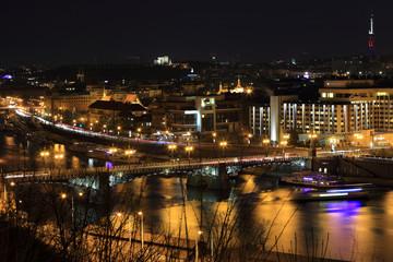 Winter night Prague City above River Vltava, Czech Republic