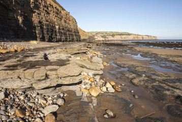 Rocks, cliffs and pools at Robin Hoods Bay, Yorkshire