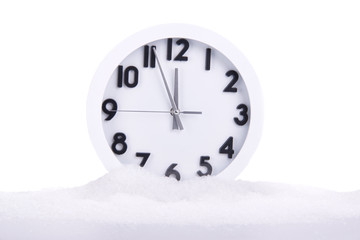 Clock covered with snow isolated on white