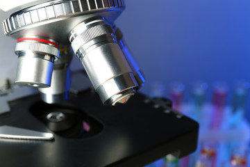 Microscope on color background, close-up