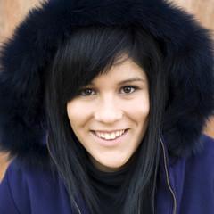 Teenage girl outdoors in fur hood