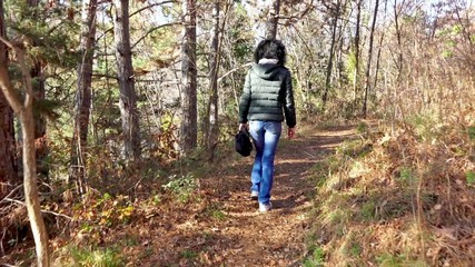 Female Walking Down a Forest Path
