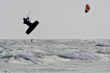 kiboarding silhouette jumping