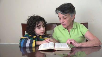 Family, two generations reading the Bible, daily devotional