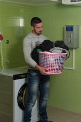 Young Man Doing Housework Laundry