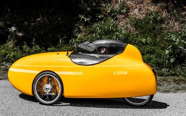 A small yellow motorbike