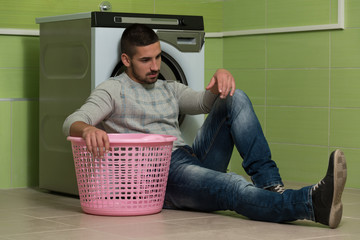 Man Waiting For The Washing
