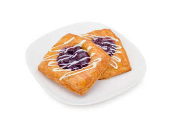 danish pastry with blueberry on white background