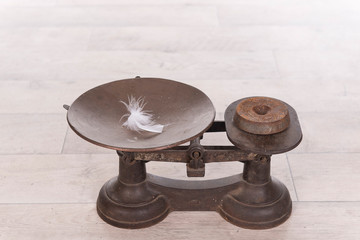 old vintage scale with weight and feather