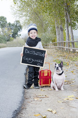child and dog hitchhiking
