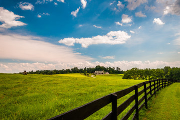 Beautiful summer sky over fence and estate in Southern York Coun