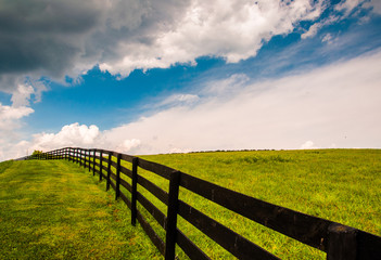 Beautiful summer sky over fence and field in Southern York Count