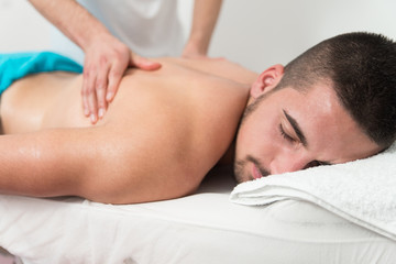Man Having Back Massage In A Spa Center