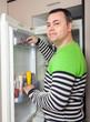 guy near opened refrigerator