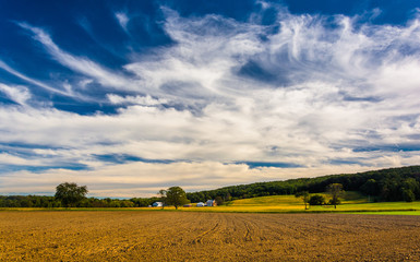 Clouds over farm fields and distant hills in rural York County,