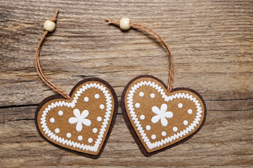 Two hearts on wooden background