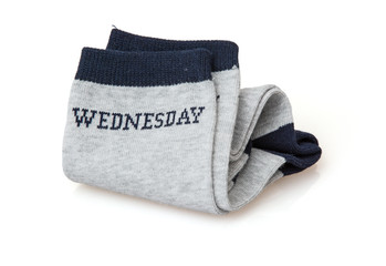 Isolated trendy wool socks with inscription WEDNESDAY