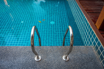 Outdoor swimming pool with grab rail