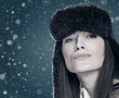 Funny female portrait with winter snowfall as backgrounds