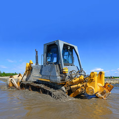 The bulldozer performs works