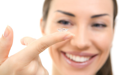 Contact lens: Young woman holding contact lens on finger in fron