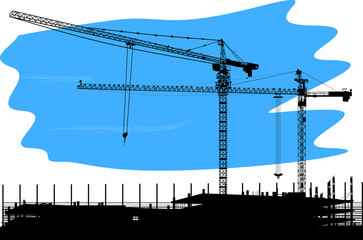 large black cranes and house building
