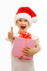 Child holding Christmas gift box in hand. Isolated on background