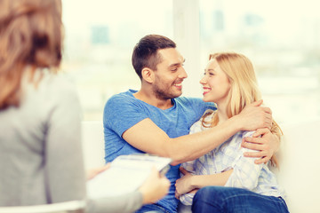 young couple hugging at psychologist office