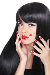 Beautiful girl with Long straight black hair. Red lips. Manicure