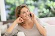 Leinwanddruck Bild - Beautiful blond woman talking on mobile phone