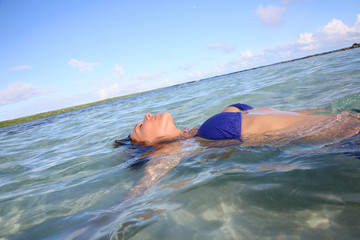Closeup of woman floating in lagoon water